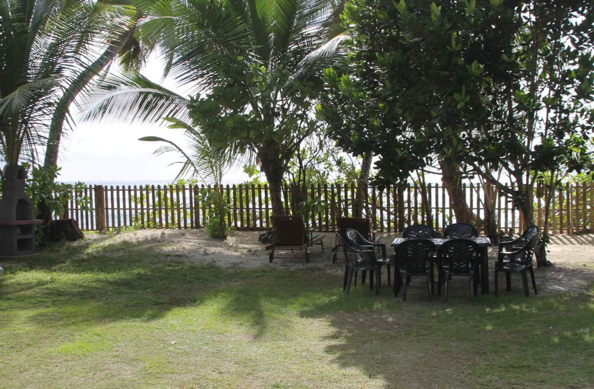 Sun downer corner, garden features 12 sun loungers with cushions, masonry BBQ and dining set