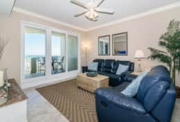 Oceanfront family room opens to a huge private balcony, comfortable couches.