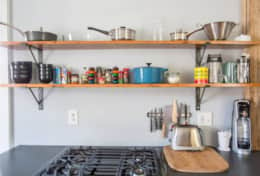 Open Shelving and a full kitchen