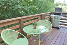 Secluded deck with Bistro table and BBQ for outdoor dining.