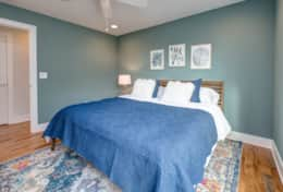 The master suite in Unit 1 includes a king-size bed, a walk-in closet, and an en-suite bath.
