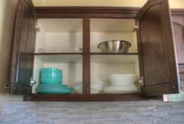 The cabinets are stocked with dishes