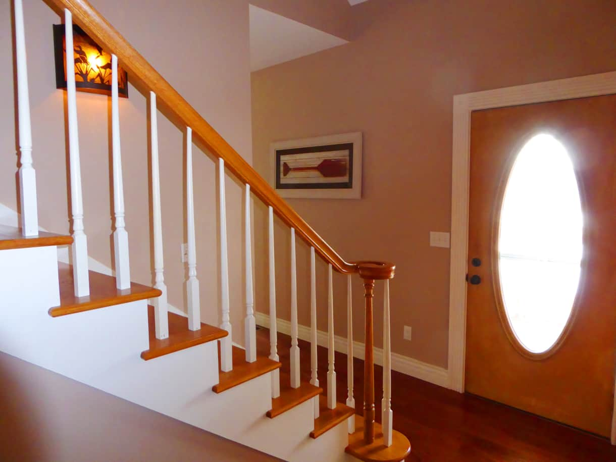 Stairs lead to a spacious landing, 2 bedrooms, & full bath