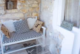 Fig cottage shaded bench on terrace