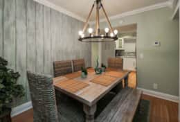 Dining for 6 at farmhouse table with custom whitewashed beachy wall by local Boca Raton artist