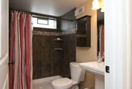This 2nd bathroom is located in the lower level and is stocked with luxurious bath towels.