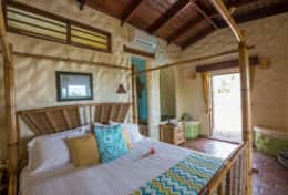 The Nutmeg Suite (Queen) offers views of the Plunge Pool, and the Caribbean Sea, from bed!