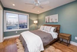 The master bedroom is outfitted with a queen-size bed, large closet, and ceiling fan.