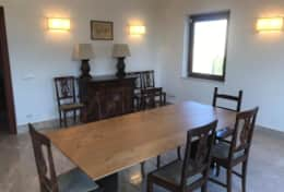 Dining area with wooden tables and seatings