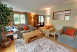Cosy open plan living space with plenty of plush comfortable sofas