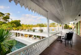 Plantation house balcony overlooking the upstairs terrace and gardens