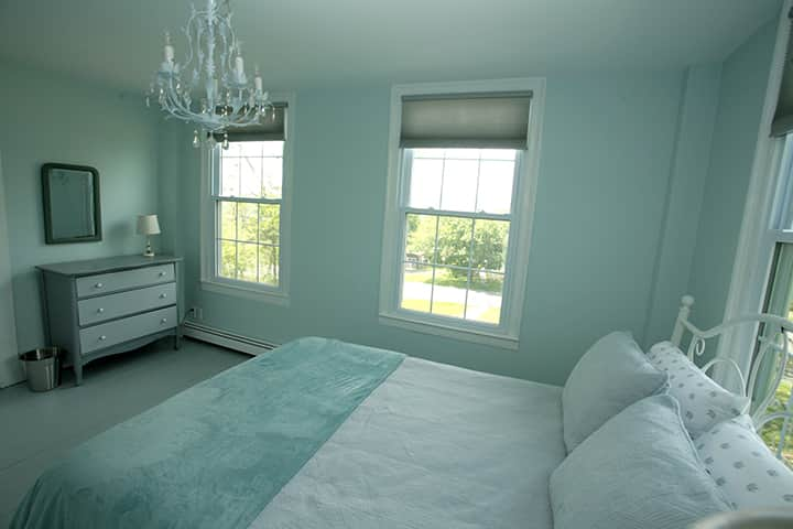 queen bed in the front blue bedroom
