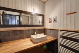 The bathroom is equipped with shower, sink and heated towel rail