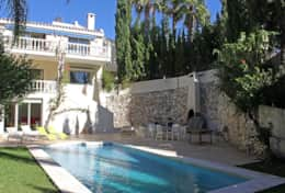 Veiw of rear of villa with pool & gardens taken from back left corner of property