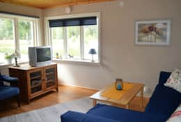 K43 Stewart Cottage - Living Room with double bed sofa & wood burning fire